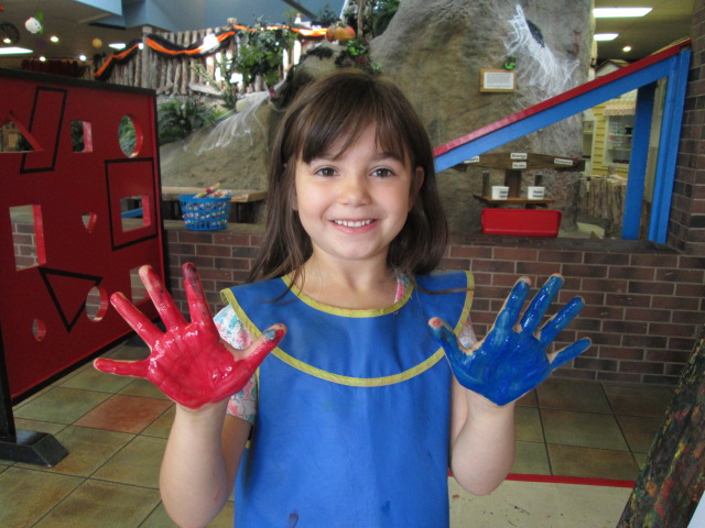 Girl with painted hands.JPG